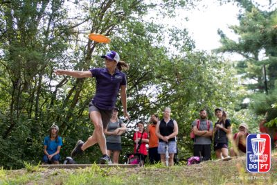 An image of ledgestone tournament opening a woman playing disc golf