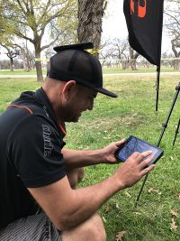 An image showing a man staying connected. Dude Clothing| Disc Golf Clothing| Disc Gold Park
