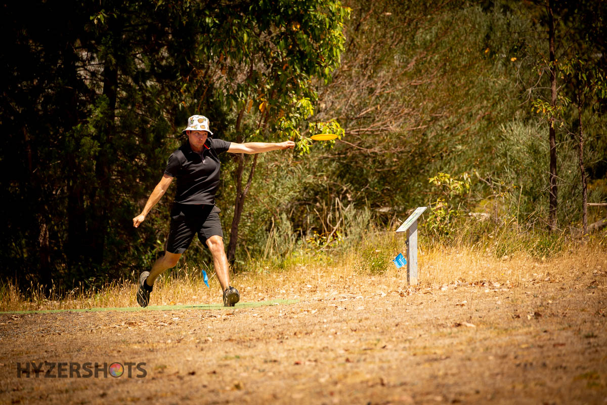 An image of woman playing disc golf