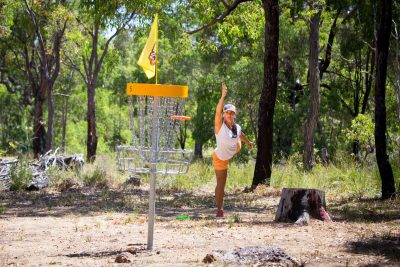 an image of a woman playing disc golf
